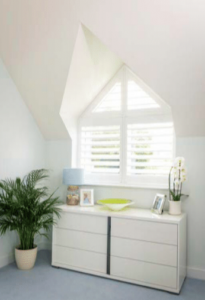 Somerset-shutters-in-bedroom-triangular-window