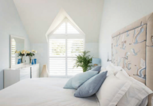 Mudeford Plantation shutters in bedroom
