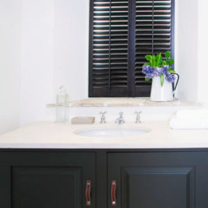 Just Shutters Wimbledon fitted beautiful black shutters in bathroom